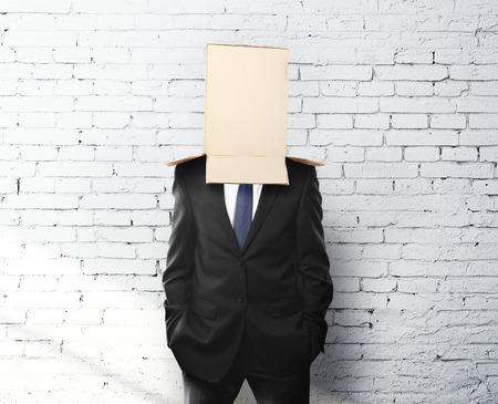 cowardice: businessman with a box on head