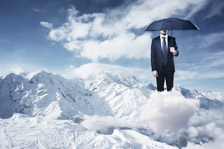 mountain top: businessman with umbrella and mountinman