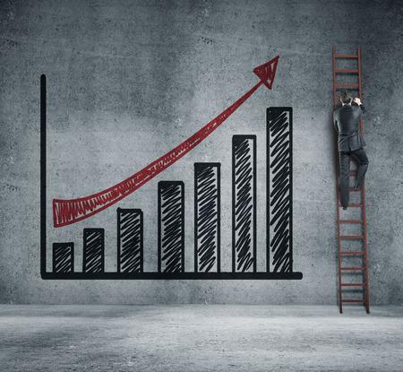 climbing ladder: businessman climbing on ladder and chart Stock Photo