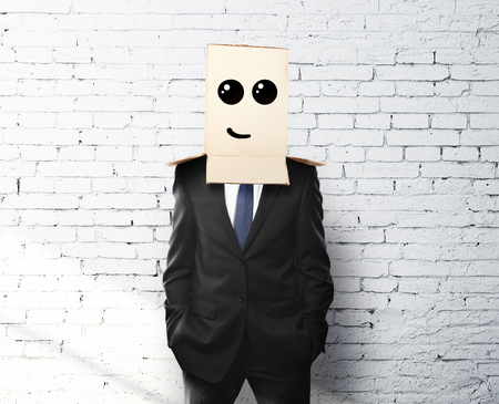 reproach: businessman with a box on head with drawing  smile