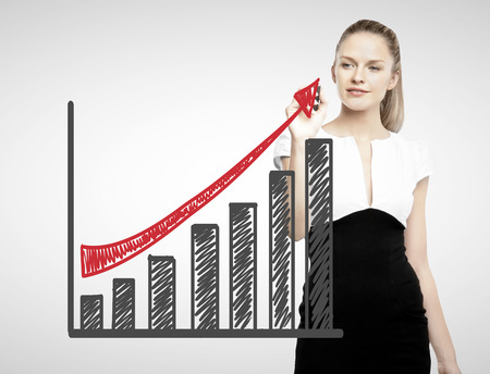 up growth: businesswoman drawing business graph with red arrow Stock Photo