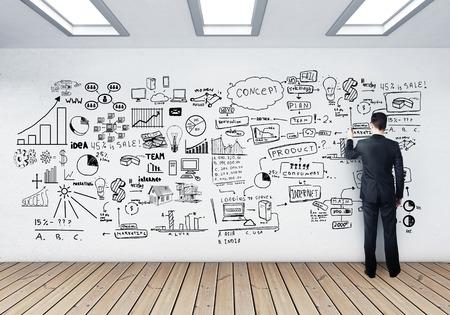bocetos de personas: empresario dibujo concepto de negocio en el muro