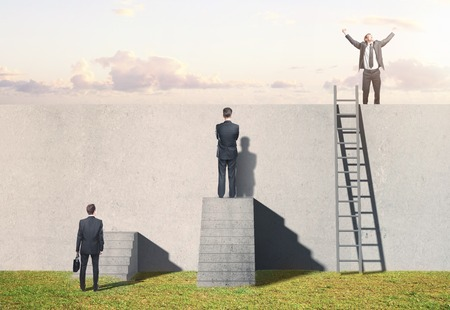 corporate ladder: man climbing on ladder on wall Stock Photo