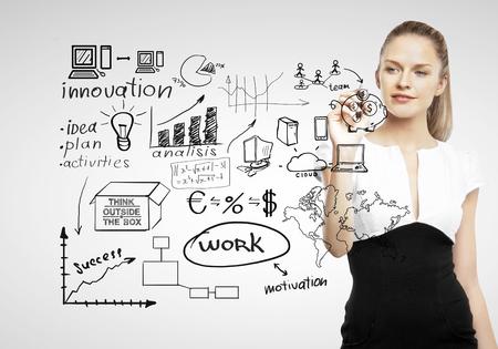 tormenta de ideas: negocios concepto de negocio de dibujo sobre fondo gris Foto de archivo