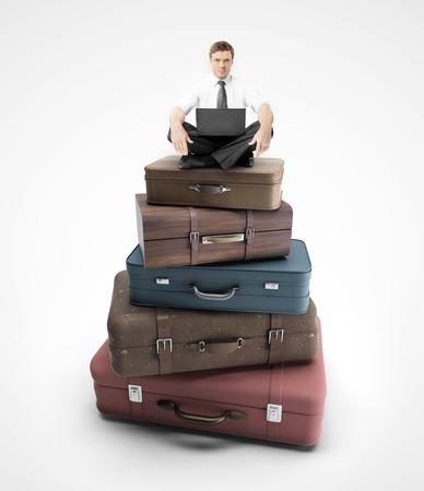 duffel: businessman sitting on travel bags
