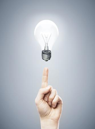 idea bulb: hands pointing at lamp,  idea concept