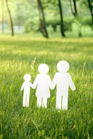 paper family on green grass Stock Photo