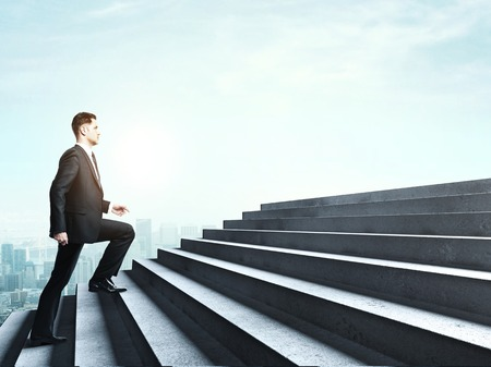climbing stairs: hombre de negocios que sube a las escaleras en la nube