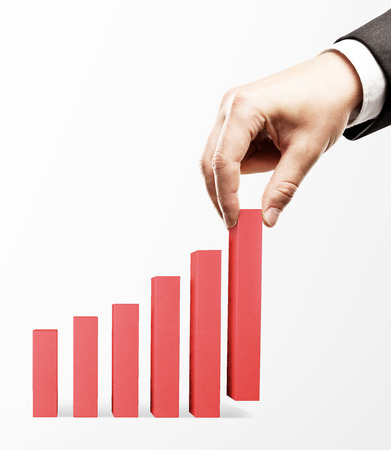 up arrow: hand holding red business graph Stock Photo