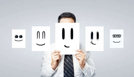 man standing alone: businessman holding paper with smile
