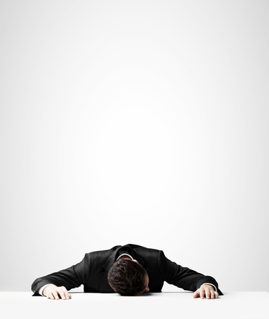 summits: businessman in suit sleeping on table