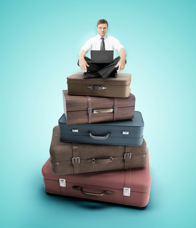 duffel: businessman sitting on travel bags, close up Stock Photo
