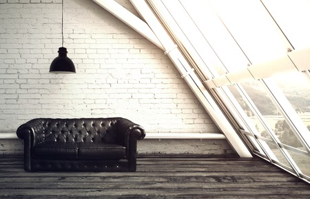 plafond: loft with window and leather sofa Stock Photo