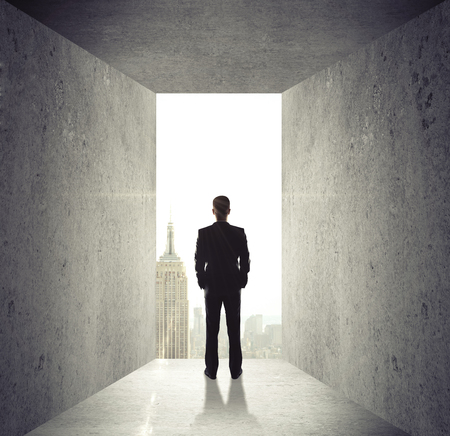 city scene: man looking at opened concrete wall to city Stock Photo