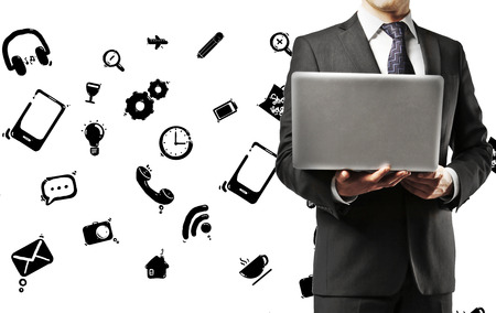 social media icons: businessman holding laptop with social icons