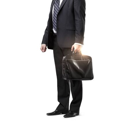 black briefcase: businessman in suit with black briefcase