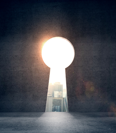 opened concrete wall and hole in form keyhole Stock Photo