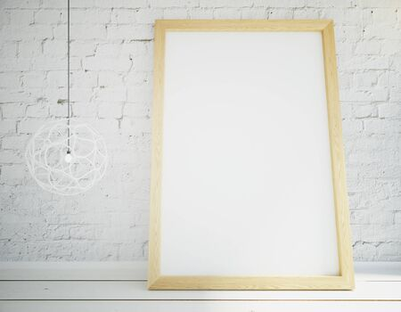 white poster: Blank picture frame on wooden table, mock up