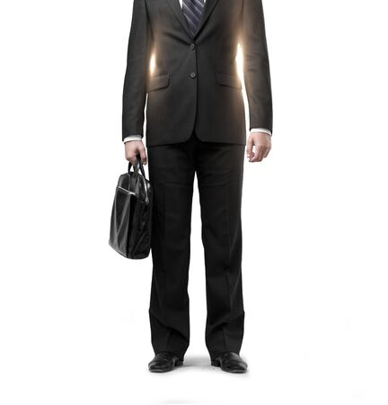 black briefcase: businessman in suit with black briefcase on gray background