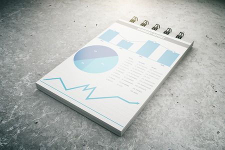 business chart: Business chart on notepad page on concrete floor, 3D Render Stock Photo