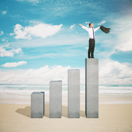 business performance: Leadership concept with happy businessman standing on the top of business graph