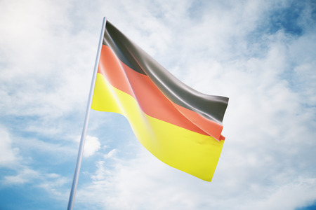 governmental: Waving German flag on a sky background