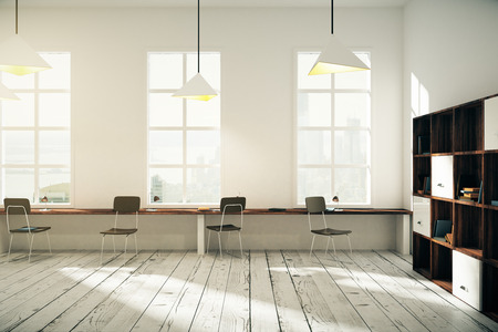 White coworking office interior design with windows, lamps, dark wooden chairs, bookshelves and light wooden floor. 3D Render