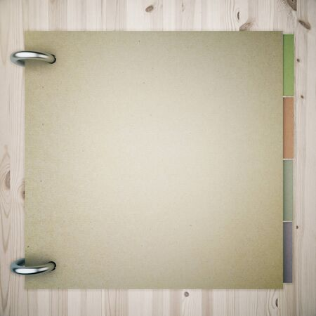books on a wooden surface: Closed blank notepad with colorful stickers inside on wooden background. Mock up, 3D Render