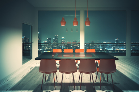 dining area: Dark dining table with red chairs in loft design room with night city view. 3D Render Stock Photo
