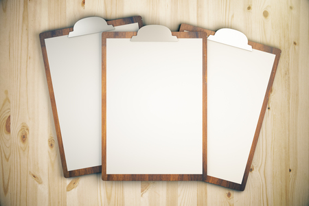 backing up: Top view of three blanks on wooden desktop. Mock up Stock Photo