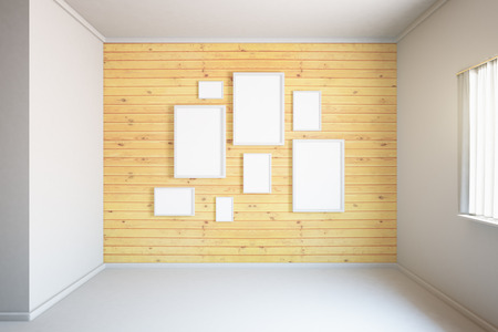 room wall: Wooden wall with blank frames in empty room interior. Mock up, 3D Render