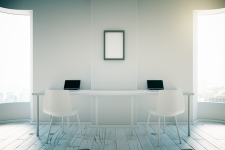workspaces: White room interior design with two workspaces, windows and a blank picture frame on the wall. 3D Render