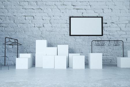 tienda de ropa: Ropa bastidores, está vacía y marco en blanco en una tienda interior con paredes de ladrillo. Maqueta, 3d Foto de archivo
