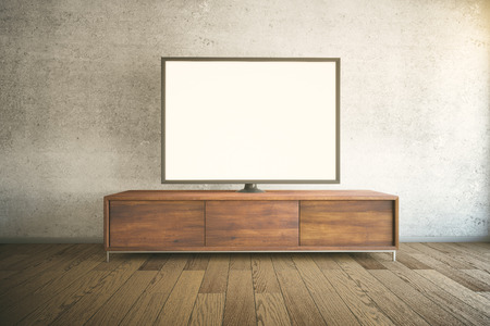 Dark wooden TV cabinet with blank white TV in room interior. Mock up, 3D Render Stock Photo