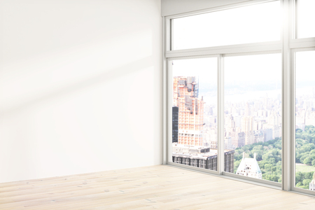 Loft interior design with blank white wall, wooden floor and tall windows revealing city view. Mock up