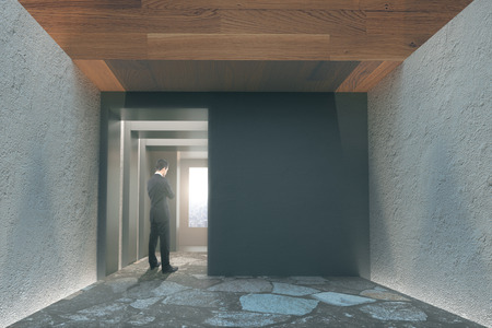 brows: Office interior with concrete walls, wooden ceiling and businessman watching the sunrise. 3D Render Stock Photo