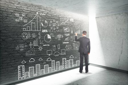 schemes: Research concept with businessman drawing business schemes on dark brick wall. 3D Render