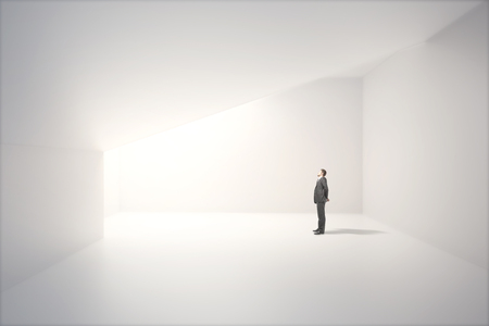 the thoughtful: Sunlit interior design with blank white concrete wall and thoughtful caucasian businessman. Mock up, 3D Render
