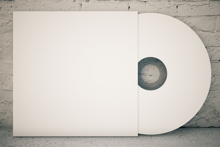 record label: White CD disk on concrete background. 3D Rendering