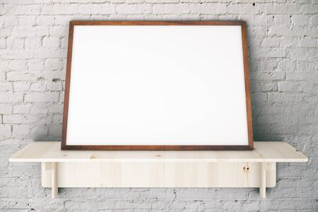 shelve: Wooden shelve with blank picture frame on white brick wall. Mock up, 3D Rendering Stock Photo