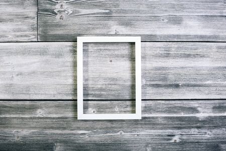 see through: Long see-through frame hanging on antique wooden wall.