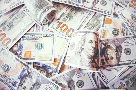 currencies: Plenty of dollar bills scattered in chaotic order