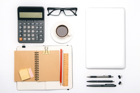 neatly: Topview of office tools and blank tablet organized neatly on white desk. Mock up