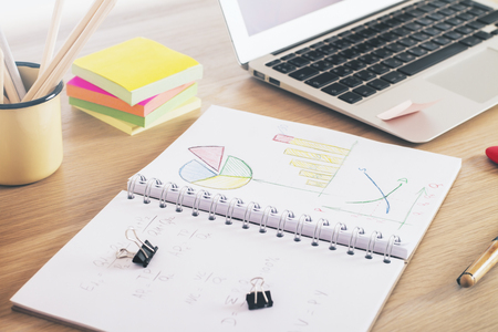 office tools: Desktop with business charts and office tools Stock Photo