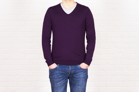 blue shirt: Male with hands in pockets, wearing jeans and purple shirt on white brick background. Mock up