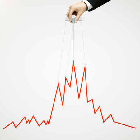 manipulating: Businessman hand manipulating graph on light background Stock Photo
