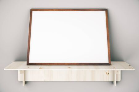 shelve: Wooden shelve with blank picture frame on grey wall. Mock up, 3D Rendering Stock Photo