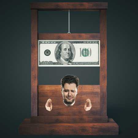 slump: Debt concept with man about to get his head chopped off on a dark wooden guillotine, isolated on black background. 3D Rendering