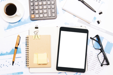 blank tablet: Topview of desktop with blank tablet and office tools. Mock up Stock Photo