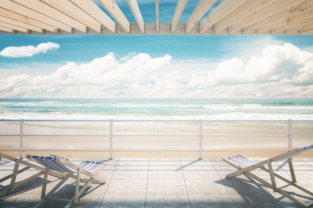 oceanside: Two chaise longues under awning at the seaside. 3D Rendering